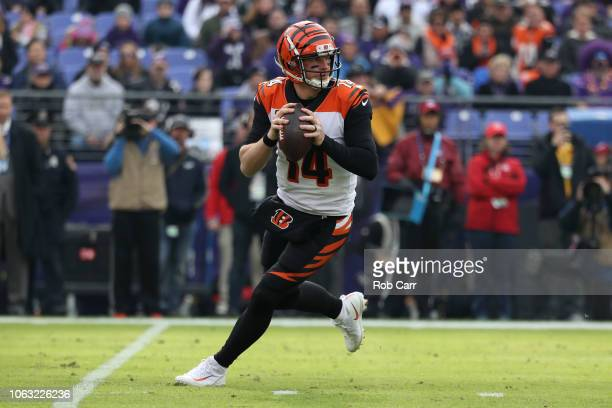 Quarterback Andy Dalton of the Cincinnati Bengals looks to throw the ball in the first quarter against the Baltimore Ravens at MT Bank Stadium on...