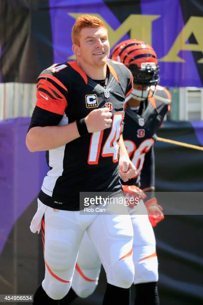 Quarterback Andy Dalton of the Cincinnati Bengals takes the field before the start of an NFL game against the Baltimore Ravens at MT Bank Stadium on...