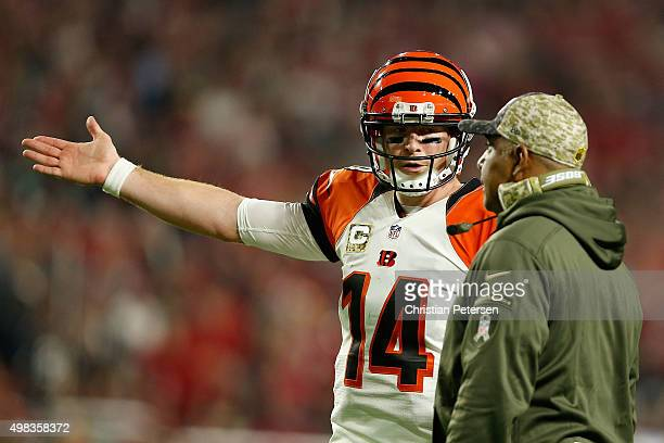 Quarterback Andy Dalton of the Cincinnati Bengals talks with head coach Marvin Lewis during the first half of the NFL game against the Arizona...