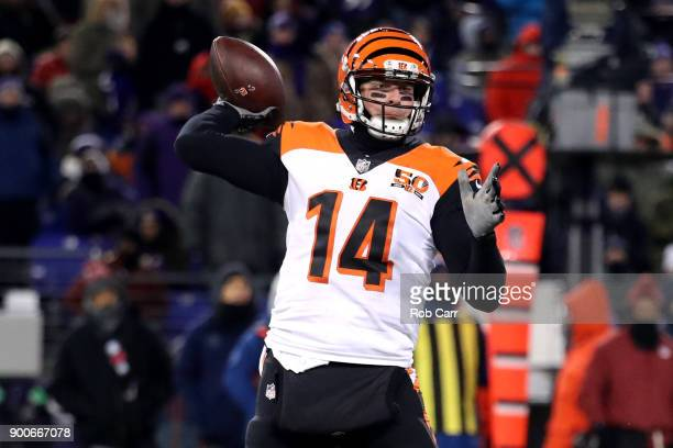 Quarterback Andy Dalton of the Cincinnati Bengals throws a pass against the Baltimore Ravens in the second half at MT Bank Stadium on December 31...
