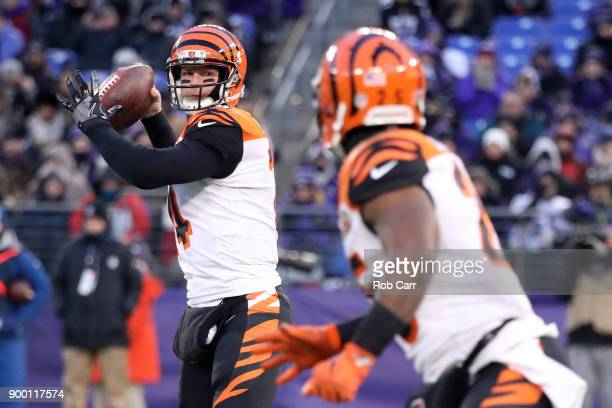 Quarterback Andy Dalton of the Cincinnati Bengals throws the ball in the first quarter against the Baltimore Ravens at MT Bank Stadium on December 31...