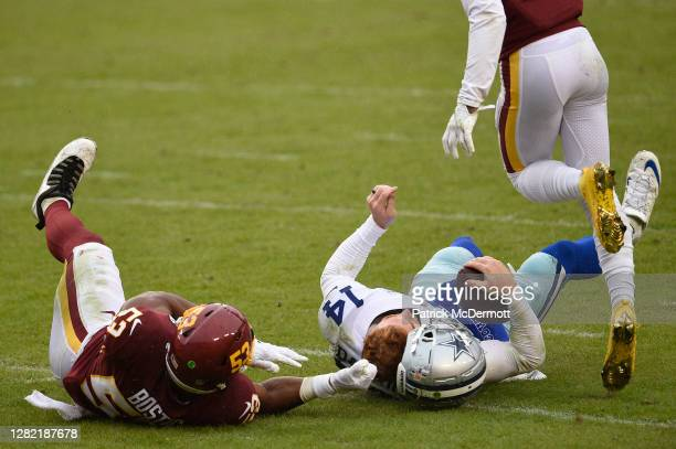 Quarterback Andy Dalton of the Dallas Cowboys is hit and injured by Jon Bostic of the Washington Football Team in the third quarter of the game at...