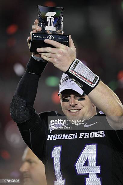 Quarterback Andy Dalton of the TCU Horned Frogs holds the offensive player of the game trophy after defeating the Wisconsin Badgers 2119 in the 97th...