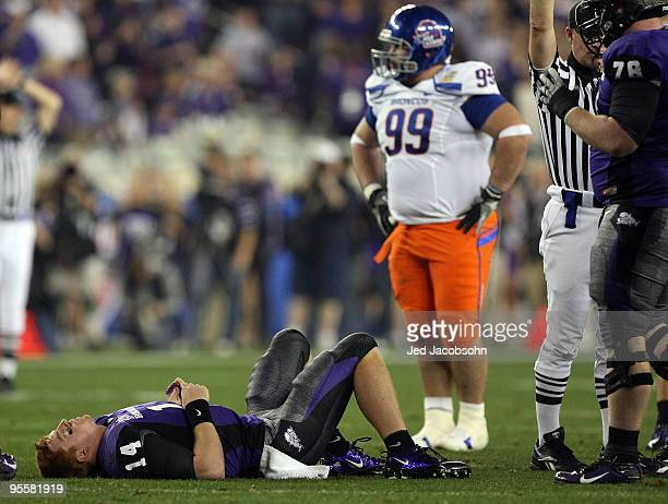 Quarterback Andy Dalton of the TCU Horned Frogs lays on the ground injured after getting sacked against the Boise State Broncos during the Tostitos...