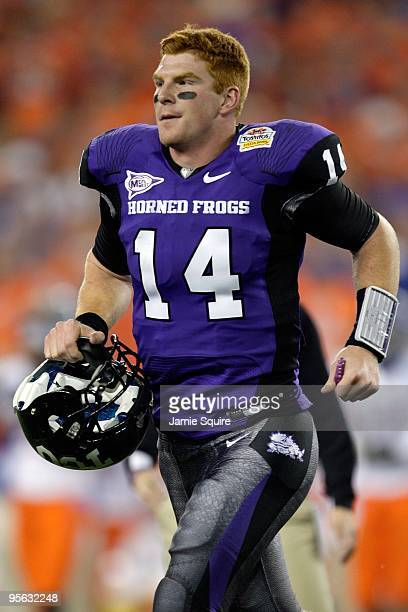 Quarterback Andy Dalton of the TCU Horned Frogs runs off the field against the Boise State Broncos during the Tostitos Fiesta Bowl at the Universtity...