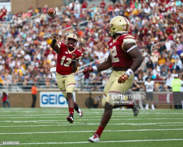 Quarterback Anthony Brown passes to running back Jon Hilliman of the Boston College Eagles to score a touchdown in the second quarter of the game...