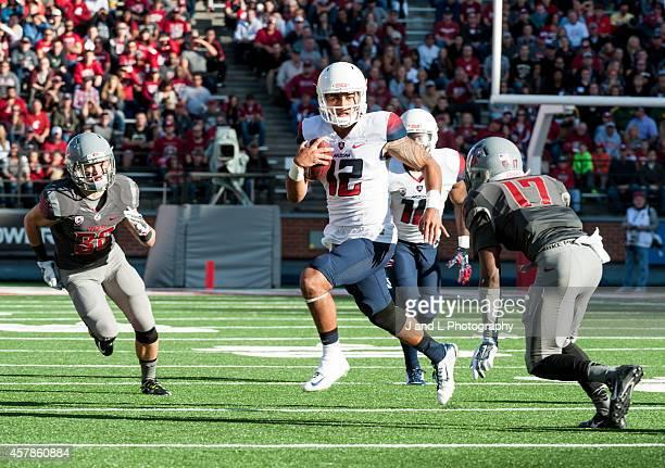 Quarterback Anu Solomon of the Arizona Wildcats avoids the tackle of cornerback Pat Porter of the Washington State Cougars at Martin Stadium on...