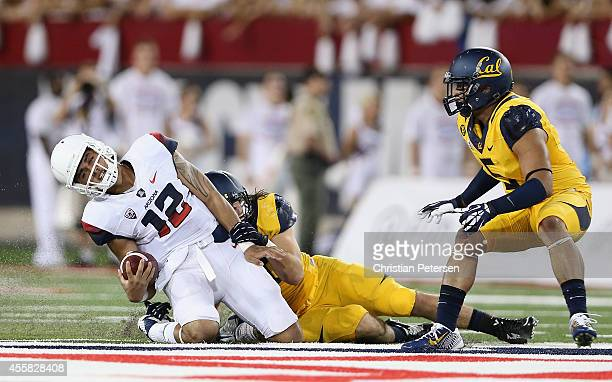 Quarterback Anu Solomon of the Arizona Wildcats is tackled after scrambling with the football against the California Golden Bears during the college...