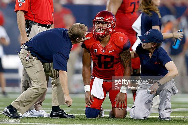 Quarterback Anu Solomon of the Arizona Wildcats reacts after an injury during the second quarter of the college football game against the UCLA Bruins...