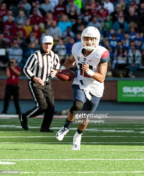 Quarterback Anu Solomon of the Arizona Wildcats runs for a short gain against the Washington Sate University Cougars at Martin Stadium on October 25,...