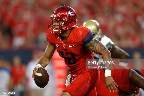 Quarterback Anu Solomon of the Arizona Wildcats scrambles with the football against the UCLA Bruins during the second quarter of the college football...