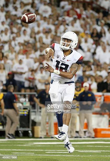 Quarterback Anu Solomon of the Arizona Wildcats throws a pass during the first half of the college football game against the California Golden Bears...