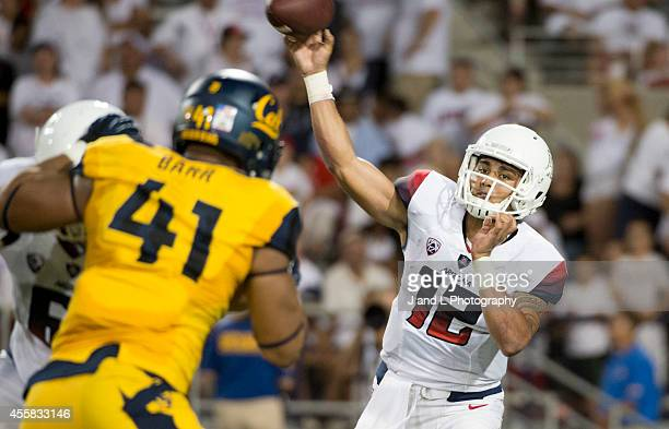 Quarterback Anu Solomon of the Arizona Wildcats throws a pass while being pressured by defensive end Todd Barr of the California Golden Bears at...