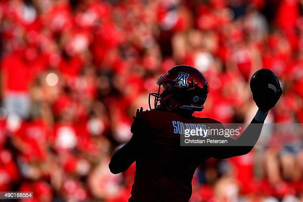 Quarterback Anu Solomon of the Arizona Wildcats warms up before the college football game against the UCLA Bruins at Arizona Stadium on September 26,...
