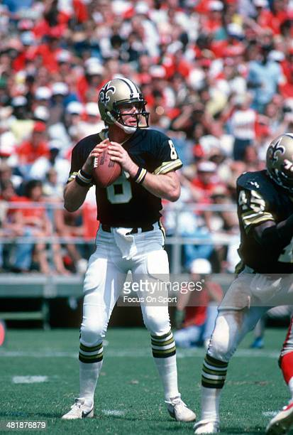 Quarterback Archie Manning of the New Orleans Saints drops back to pass against the Atlanta Falcons during an NFL football game at AtlantaFulton...