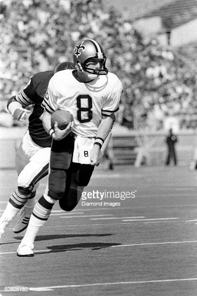 Quarterback Archie Manning of the New Orleans Saints runs the ball during a game on October 2 1977 against the Chicago Bears at Soldier Field in...