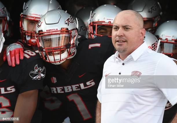 Quarterback Armani Rogers and head coach Tony Sanchez of the UNLV Rebels prepare to take the field before their game against the Howard Bison at Sam...