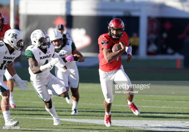 UNLV quarterback Armani Rogers looks down the field as he runs the ball during a game against Hawaii on November 04 at Sam Boyd Stadium in Las Vegas...
