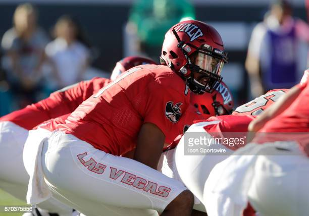 UNLV quarterback Armani Rogers looks down the offensive line during a game against Hawaii on November 04 at Sam Boyd Stadium in Las Vegas Nevada The...