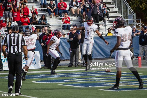 Quarterback Armani Rogers of the UNLV Rebels celebrates a touchdown run against the Nevada Wolf Pack at Mackay Stadium on November 25 2017 in Reno...