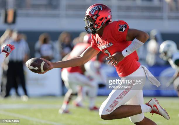 UNLV quarterback Armani Rogers runs with the ball during a game against Hawaii on November 04 at Sam Boyd Stadium in Las Vegas Nevada The UNLV Rebels...