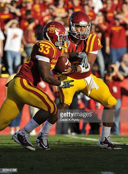 Quarterback Austen Arnaud of the Iowa State Cyclones hands off to running back Alexander Robinson during the game against the Oklahoma State Cowboys...