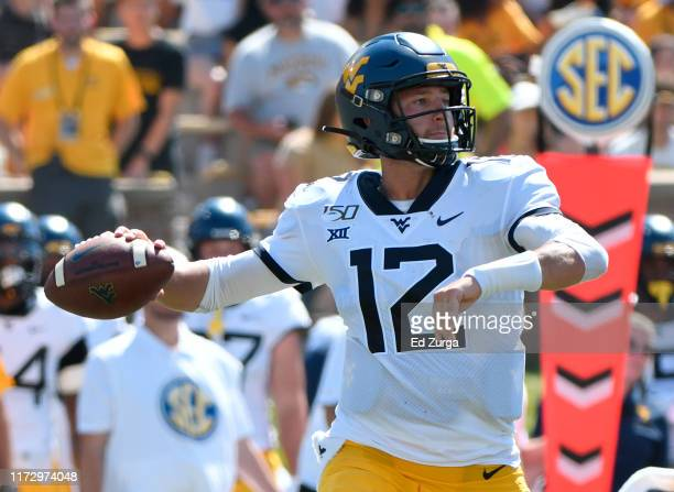 Quarterback Austin Kendall of the West Virginia Mountaineers looks to pass against the Missouri Tigers in the second half at Faurot Field/Memorial...