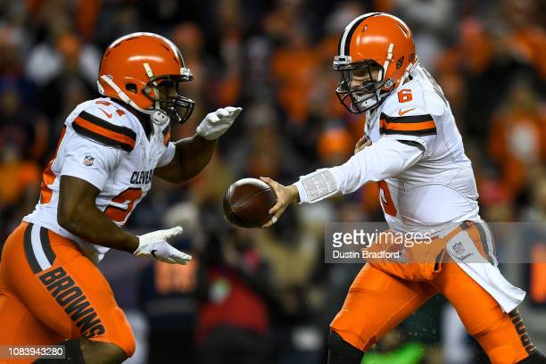 Quarterback Baker Mayfield hands off the ball to running back Nick Chubb of the Cleveland Browns in the first quarter of a game against the Denver...