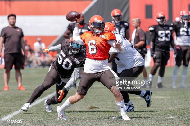 Quarterback Baker Mayfield is being rushed by Defensive End Chris Smith during the Cleveland Browns Training Camp on August 5 2019 at the Cleveland...