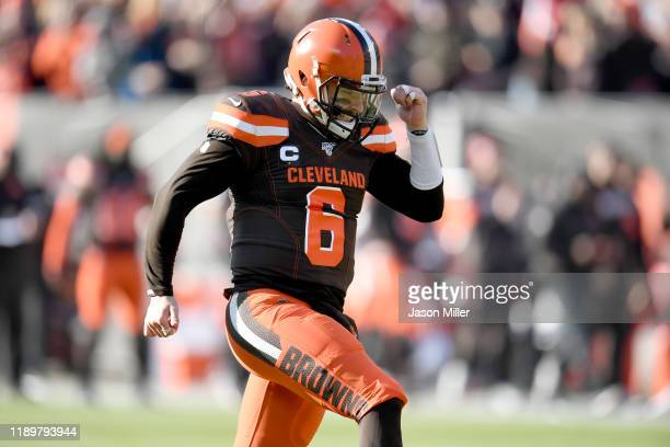 Quarterback Baker Mayfield of the Cleveland Browns celebrates after throwing a touchdown pass to wide receiver Odell Beckham of the Cleveland Browns...