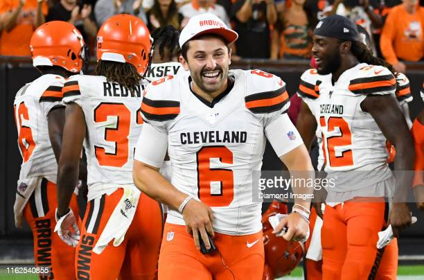 Quarterback Baker Mayfield of the Cleveland Browns celebrates with teammates after a punt return for a touchdown by wide receiver Damon...