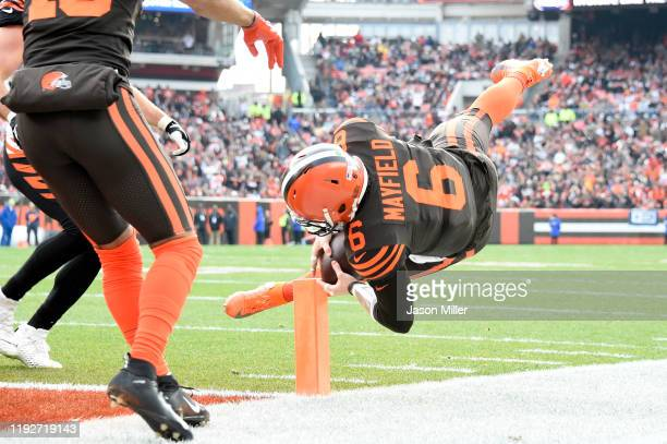 Quarterback Baker Mayfield of the Cleveland Browns dives in for a touchdown during the first half against the Cincinnati Bengals at FirstEnergy...