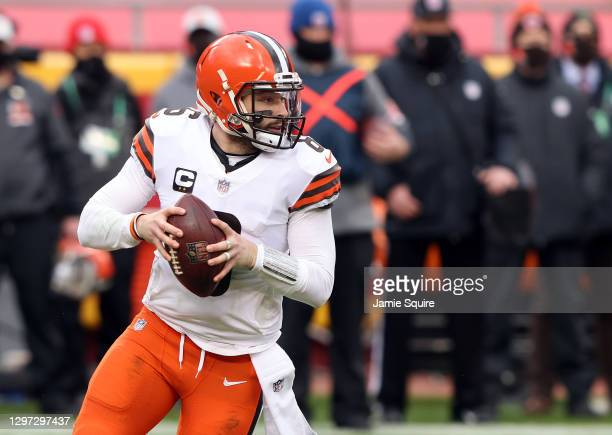 Quarterback Baker Mayfield of the Cleveland Browns drops back to pass against the defense of the Kansas City Chiefs during the AFC Divisional Playoff...