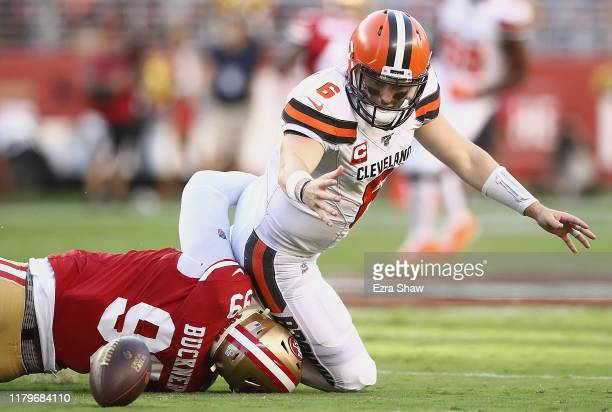 Quarterback Baker Mayfield of the Cleveland Browns fumbles as he is tackled by DeForest Buckner of the San Francisco 49ers during the game at Levi's...