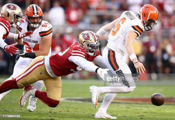 Quarterback Baker Mayfield of the Cleveland Browns fumbles as he is pursued by DeForest Buckner of the San Francisco 49ers during the game at Levi's...
