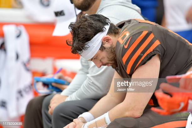 Quarterback Baker Mayfield of the Cleveland Browns hangs his head while on the bench during the second half against the Tennessee Titans at...