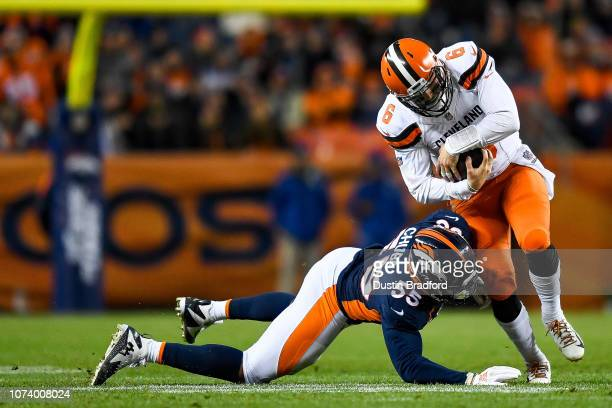 Quarterback Baker Mayfield of the Cleveland Browns is hit by outside linebacker Bradley Chubb of the Denver Broncos on a rush attempt in the third...