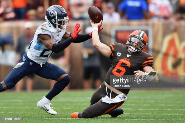Quarterback Baker Mayfield of the Cleveland Browns is sacked by Logan Ryan of the Tennessee Titans in the second quarter at FirstEnergy Stadium on...