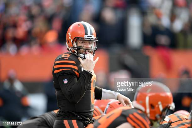 Quarterback Baker Mayfield of the Cleveland Browns prepares to take the snap from the line of scrimmage during the second half against the Cincinnati...