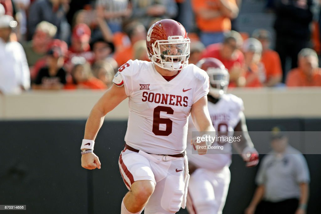 Quarterback Baker Mayfield #6 of the Oklahoma Sooners celebrates a touchdown against the Oklahoma State Cowboys at Boone Pickens Stadium on November 4, 2017 in Stillwater, Oklahoma. Oklahoma defeated Oklahoma State 62-52.