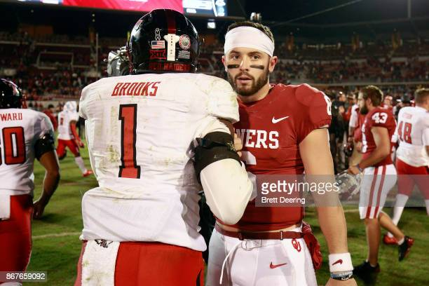 Quarterback Baker Mayfield of the Oklahoma Sooners greets linebacker Jordyn Brooks of the Texas Tech Red Raiders of the Oklahoma Sooners after the...