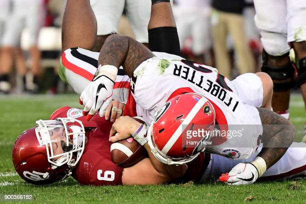 Quarterback Baker Mayfield of the Oklahoma Sooners is sacked by defensive end Jonathan Ledbetter of the Georgia Bulldogs in the second half in the...