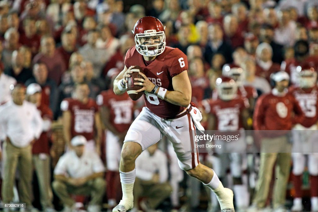 Quarterback Baker Mayfield #6 of the Oklahoma Sooners looks to throw against the TCU Horned Frogs at Gaylord Family Oklahoma Memorial Stadium on November 11, 2017 in Norman, Oklahoma. Oklahoma defeated TCU