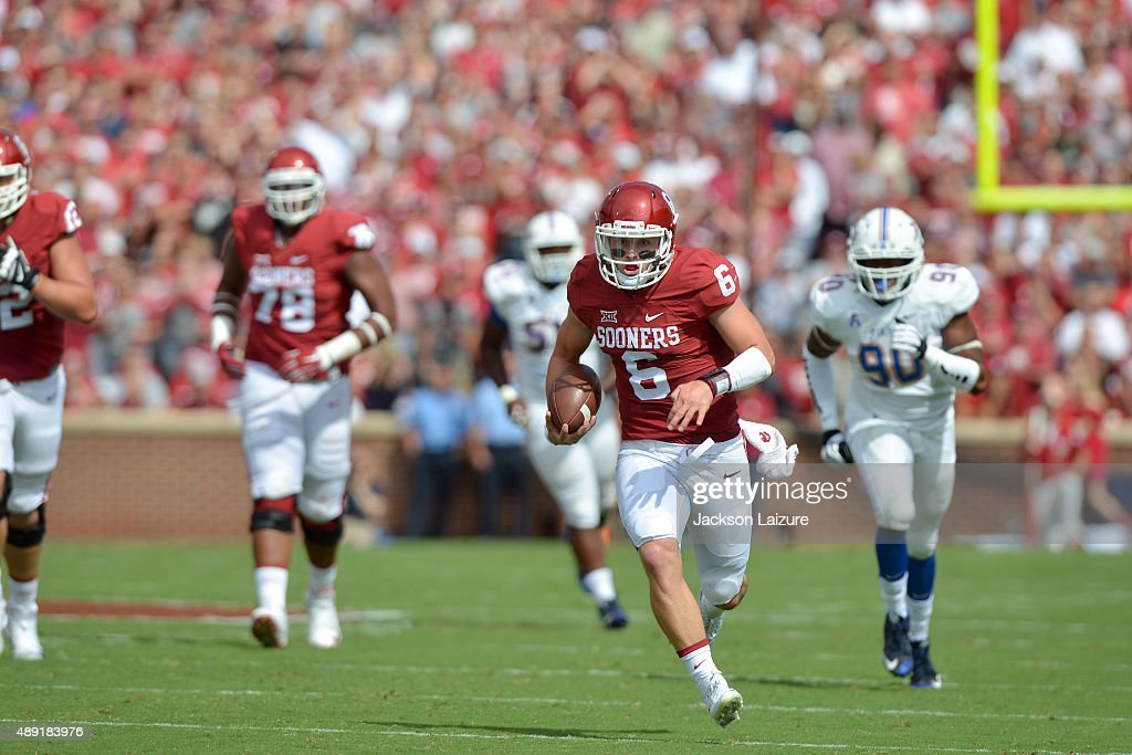 Quarterback Baker Mayfield #6 of the Oklahoma Sooners runs for a touchdown against the Tulsa Golden Hurricane at Gaylord Family Memorial Stadium on September 19, 2015 in Norman, Oklahoma.