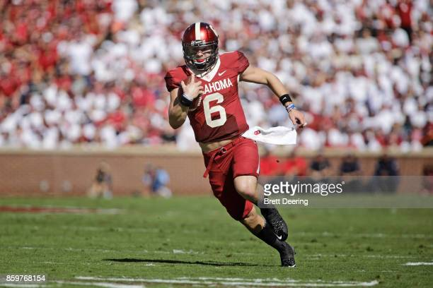 Quarterback Baker Mayfield of the Oklahoma Sooners runs in open field against the Iowa State Cyclones at Gaylord Family Oklahoma Memorial Stadium on...