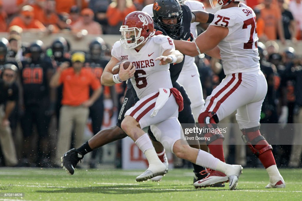 Quarterback Baker Mayfield #6 of the Oklahoma Sooners scrambles out of the pocket against the Oklahoma State Cowboys at Boone Pickens Stadium on November 4, 2017 in Stillwater, Oklahoma. Oklahoma defeated Oklahoma State 62-52.