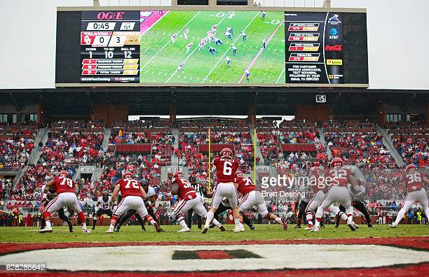 Quarterback Baker Mayfield of the Oklahoma Sooners takes a snap during the game Oklahoma State Cowboys December 3 2016 at Gaylord FamilyOklahoma...