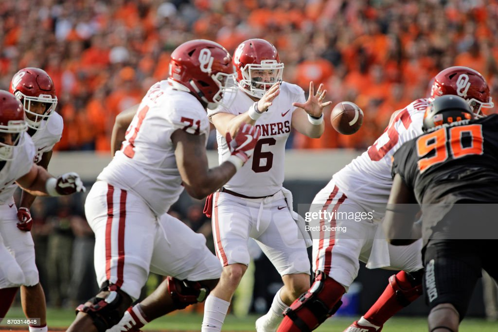 Quarterback Baker Mayfield #6 of the Oklahoma Sooners takes a snap against the Oklahoma State Cowboys at Boone Pickens Stadium on November 4, 2017 in Stillwater, Oklahoma. Oklahoma defeated Oklahoma State 62-52.