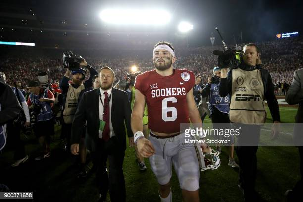 Quarterback Baker Mayfield of the Oklahoma Sooners walks off the field after losing to the Georgia Bulldogs 5448 in the 2018 College Football Playoff...