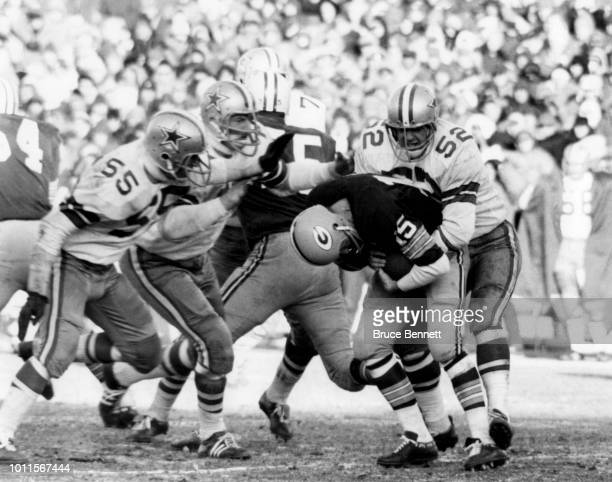 Quarterback Bart Starr of the Green Bay Packers is tackled by Dave Edwards and Lee Roy Jordan of the Dallas Cowboys during the 1967 NFL Championship...